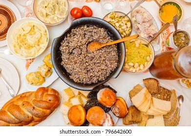 Traditional Ukrainian food.Kutya, dumplings, cabbage rolls on festive table.