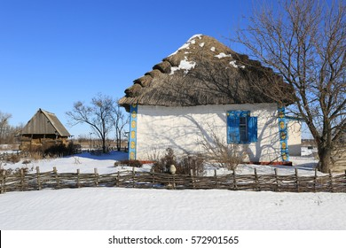 Traditional ukrainian old-style house with thatch roof