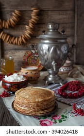 Traditional Ukrainian pancakes with cottage cheese and milk on vintage wooden table background