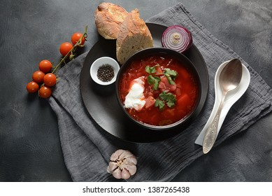 Traditional Ukrainian Russian borscht . Bowl of red beet root soup borsch with white cream . Beet Root delicious soup . Traditional Ukrain food cuisine
