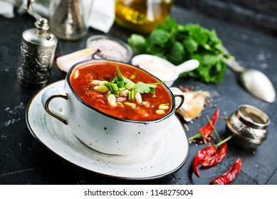 Traditional Ukrainian Russian borscht with white beans on the bowl. Plate of red beet root soup