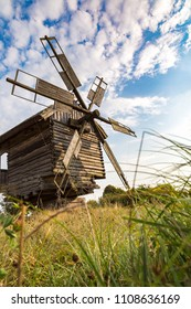 Traditional ukrainian windmill in the museum of national architecture in Pirogovo in a beautiful summer day, Kiev, Ukraine