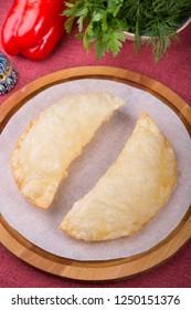 Traditional uzbek fried cheburek dough stuffed with meat