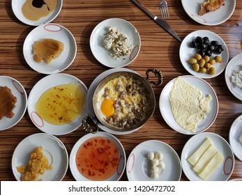 Traditional Van Breakfast.(Van Kahvaltisi) Sausage, cheddar cheese, roasting, Turkish tea. Local delicacies. Van - Turkey.
