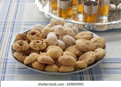 Traditional variety of festive Moroccan cookies and mint tea