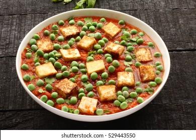 Traditional vegetarian curry paneer matar sabji masala.