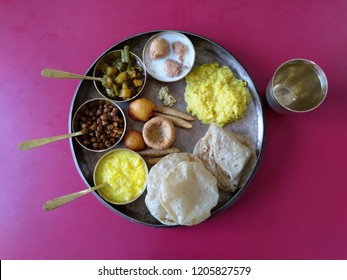 Traditional vegetarian dish served to Godess Amba on last day of Navratri festival as a religious rituals in Ahmedabad, Gujarat, India