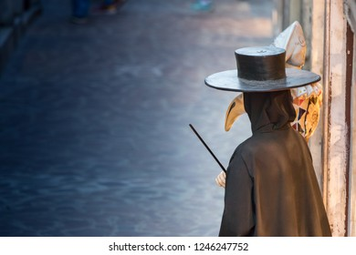 Traditional venetian mannequin in Plague doctor costume, mask and hat near shop window in the street of Venice, Italy.