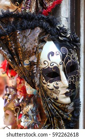 Traditional Venetian mask in store on street, Venice, Lombardy, Italy.