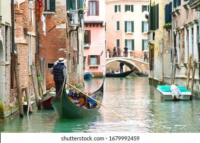 Traditional Venice Cityscape with narrow canal, gondola