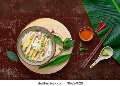 Traditional vietnamese noodle soups pho in bowls, concrete background. Vietnamese chicken soup. Healthy vietnamese dinner. Pho ga soup meal