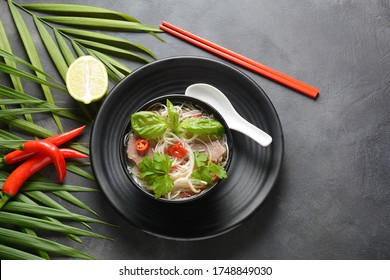 Traditional Vietnamese soup Pho bo with herbs,beef, rice noodles,chili and  bean sprouts . Vietnamese Cuisine. Asian food