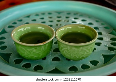Traditional Vietnamese tea served in small green cups in a restaurant in Hanoi, Sapa, Vietnam