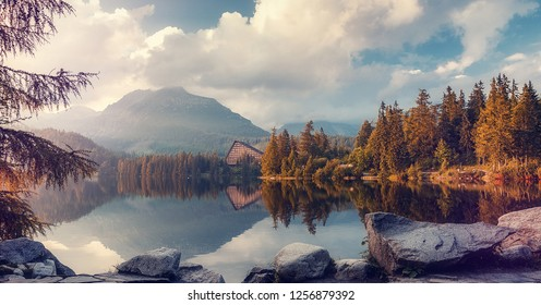 Traditional view to mountain lake Strbske pleso in National Park Vysoke Tatry. Slovakia. Awesome Nature Landscape. Wonderful Natural Background for postcard. Beautiful locations of the World