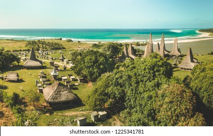 "Traditional village. Aerial drone shot. Indonesia. Authentic huts called ""ratenggaro"" with straw roofs intermingle with tombs in the local settlement, surrounded by the greens. Sumba island."