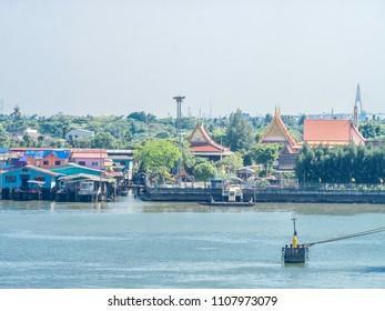 Traditional village along the banks of a river near Bangkok, Thailand