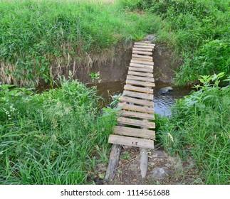 traditional village bridge across the creek, southern Bohemia, Czech Republic