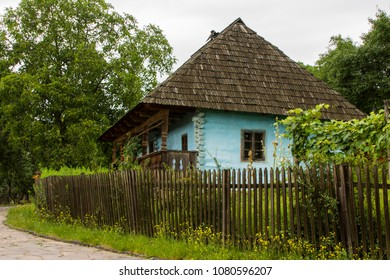 Traditional village historical building of Western Ukraine, where the roof is covered with wooden tiles. Skansen Uzhhorod. Ukraine