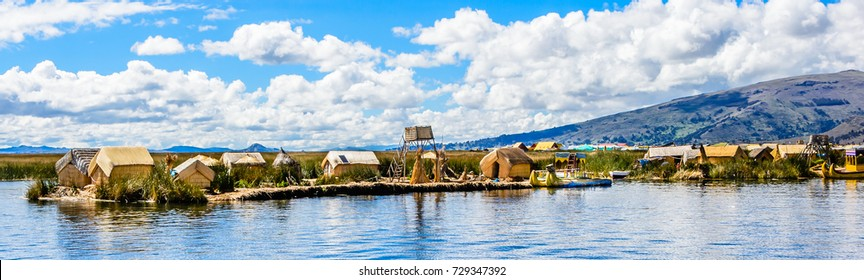 Traditional village on floating  Uros  islands on lake Titicaca near city of Puno , Peru, South America, wide format