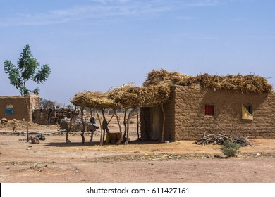 Traditional village scene in Niger with farmland and housing, Niger, Africa