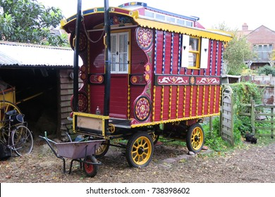 Traditional vintage classic old fashioned traveller / gypsy caravan, Red. UK