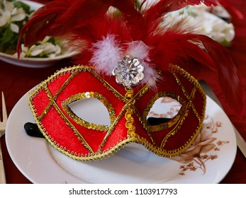 Traditional vintage festive decorated red and gold face Venice Carnival Festival mask Italy
