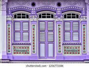 Traditional vintage Straits Chinese or Peranakan Chinese shop house with antique wooden shutters and ornate colourful exterior in historic Joo Chiat Singapore