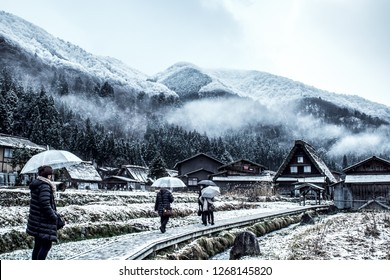 Traditional Wada House in Shirakawa-go, one of the world herritage, during the winter with tourist and rice field covered in snow