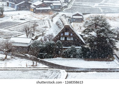 Traditional Wada House in Shirakawa-go, one of the world herritage, during the winter while it's snowing from high angle