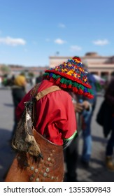Traditional water seller in red uniform in the Djemma el Fna, Marrakech,  Morocco, Africa