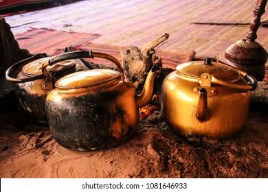Traditional way of cooking Bedouin tea on an open fire in a desert Wadi Rum, Jordan
