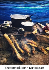 Traditional way of cooking food over an open fire.