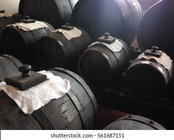 Traditional way of making balsamic vinegar. Barrels with vinegar waiting to mature.