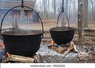 Traditional way of making maple syrup by boiling the sap in a cauldron  at sugar shack