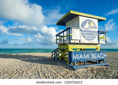 Traditional weathered wooden lifeguard tower in faded colors standing in setting sun on South Beach in Miami, Florida, USA