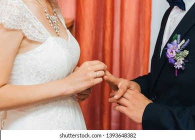 traditional wedding ceremony of exchange of gold rings between the bride and groom. Vows to strengthen the family Union and to be together forever