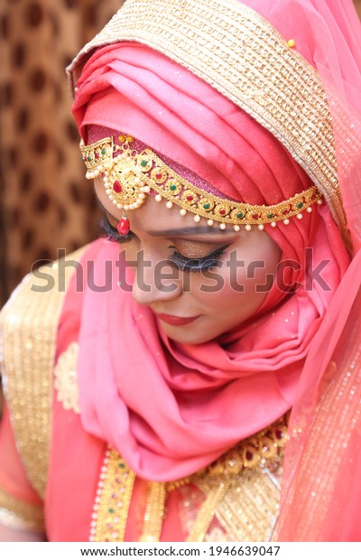 Traditional wedding concept. Bride is posing for a bridal shot. Happy married life. Indian cultural program. Elegant jewelry fashion for a magazine cover. Luxury lifestyle. Portrait of Indian bride