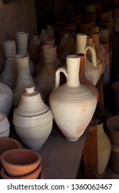 Traditional wheel thrown water jugs and ancient style ceramic piggy banks