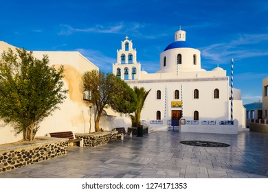 Traditional white church with a blue dome on Santorini island, Greece