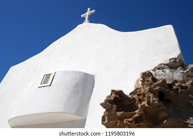 Traditional white church on the highest spot of Chora, the capital of Ios island, Cyclades, Greece