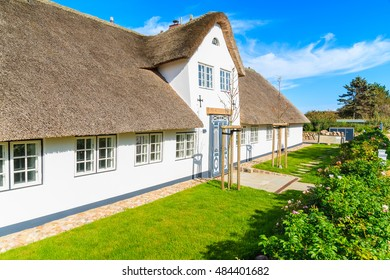 Traditional white house with thatched roof in Wenningsted village on Sylt island, Germany