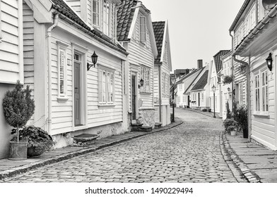 Traditional white old wooden houses in Stavanger, Norway. Black and white image.