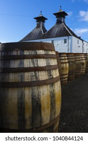 Traditional white painted building with black double tower roof of Scottish Whisky distillery.