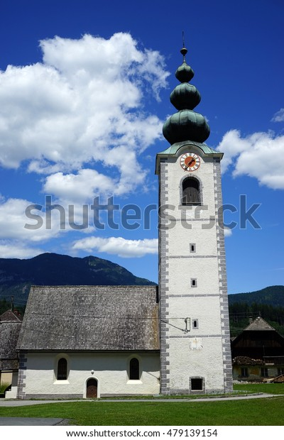 Traditional white stone church with bell tower in village, Austria