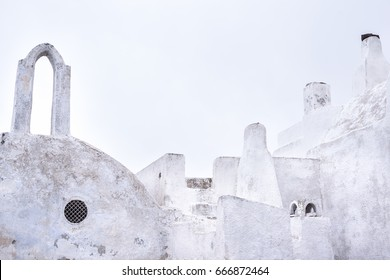 Traditional white washed roofs. Architecture of Pyrgus Santorini island Greece