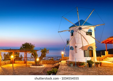 Traditional Wind Mills in Greece, Zakynthos Island. Incredibly romantic sunrise on Zakinthos. Amazing sunset view on old mill with multicolored clouds. Old Windmill in Agios Nikolaos near blue caves.