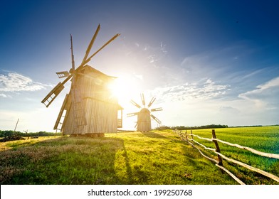 A traditional windmill on the countryside. sunset