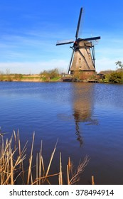 Traditional windmill surrounded by water in Kinderdijk, Holland