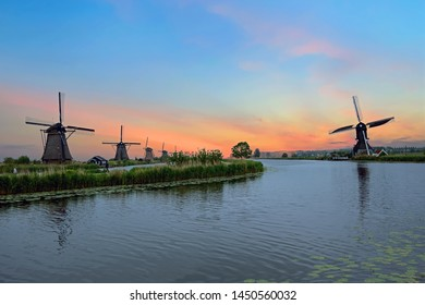Traditional windmills at Kinderdijk in the Netherlands at sunset