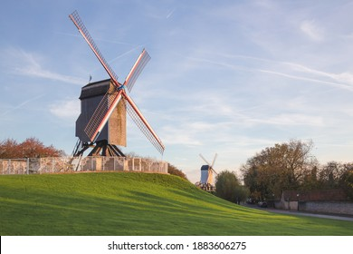 Traditional windmills in Park Kruisvest on a sunny autumn day in Bruges, Belgium